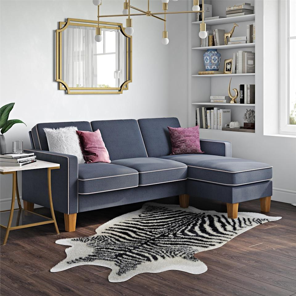 "<h3>Small-Space Sectional Sofa</h3><p>This compact sectional features stylish contrast-welting details with smooth walnut-finished legs and a sweet under $500 price tag — customers coo: ""Great $500 apartment couch! Just received today...was so easy to put together! No screws etc, just snapping in and I put together by myself. It comes in one big long box with 6 pieces plus the cushions and legs. I ordered the grey, it is darker than in the walmart picture, which I was glad about. The chaise does not attach so you can move to either side. I have been sitting on it and it does not move. Works perfect in my studio apt!""</p><br><br><strong>Novogratz Collection</strong> Bowen Sectional Sofa with Contrast Welting, Blue, $407.99, available at <a href=""https://www.walmart.com/ip/Novogratz-Bowen-Sectional-Sofa-with-Contrast-Welting-Blue/927035486"" rel=""nofollow noopener"" target=""_blank"" data-ylk=""slk:Walmart"" class=""link rapid-noclick-resp"">Walmart</a>"