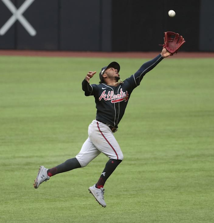 Atlanta Braves second baseman Ozzie Albies can't reach a fourth inning single by Dodgers catcher Austin Barnes.