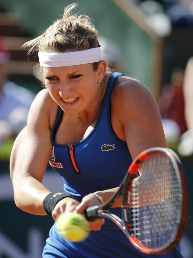 Timea Bacsinszky of Switzerland returns the ball to Serena Williams of the U.S. during their women's semi-final match at the French Open tennis tournament at the Roland Garros stadium in Paris, France, June 4, 2015. REUTERS/Pascal Rossignol