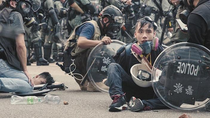 Protesters detained by riot police