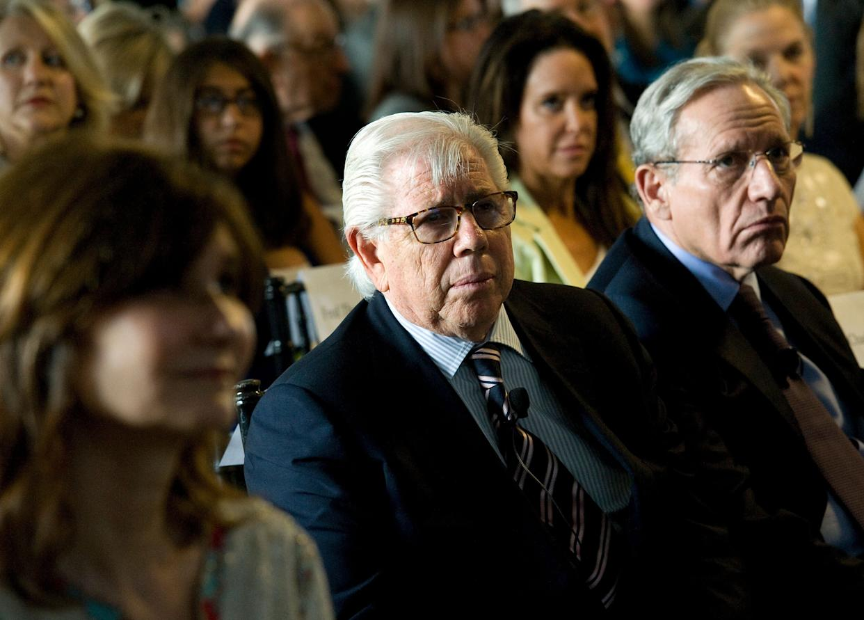 WASHINGTON, DC - JUNE 11: Watergate reporters Carl Bernstein, center, and Bob Woodward, right, listen in on a discussion during a 40th anniversary Watergate event at The Watergate office complex on June 11, 2012 in Washington, D.C. To mark the 40th anniversary of Watergate, The Washington Post via Getty Images hosted a live event and discussion including major players from the event and also reporters Woodward and Bernstein who broke the story. (Photo by Ricky Carioti/The Washington Post via Getty Images)