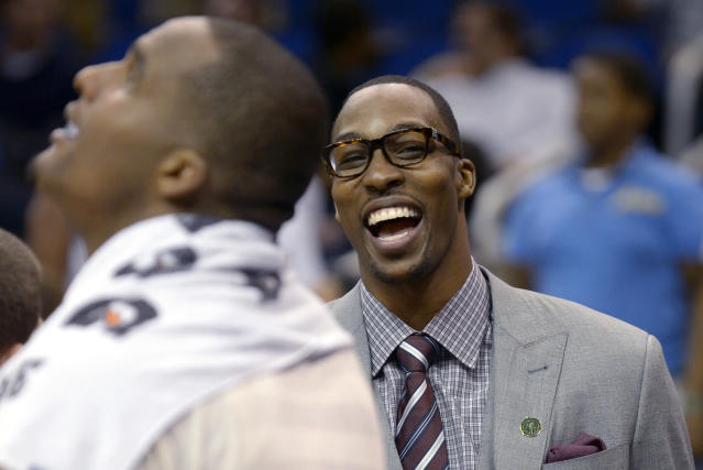 Orlando Magic center Dwight Howard, right, has a laugh with Glen Davis during a timeout near the end of the second half of an NBA basketball game against the Detroit Pistons in Orlando, Fla., Monday, April 9, 2012. The Magic won 119-89. (AP Photo/Phelan M. Ebenhack)
