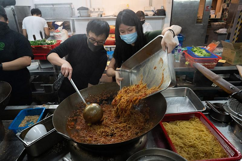 Volunteers, some of whom had never cooked before, help prepare food for the protestors gathered at PolyU, Nov. 14. | Bing Guan