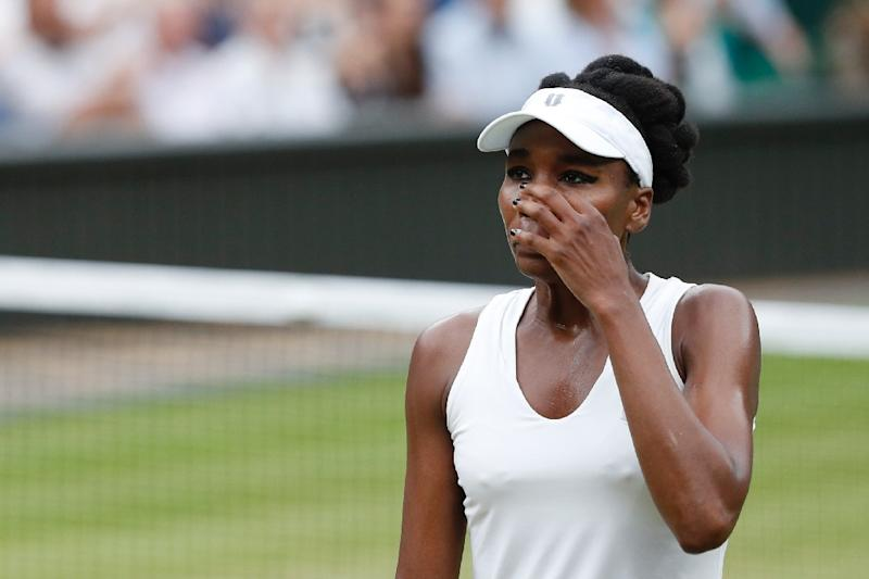 US player Venus Williams reacts against Spain's Garbine Muguruza during their women's singles final match on the twelfth day of the 2017 Wimbledon Championships at The All England Lawn Tennis Club in Wimbledon, southwest London, on July 15, 2017