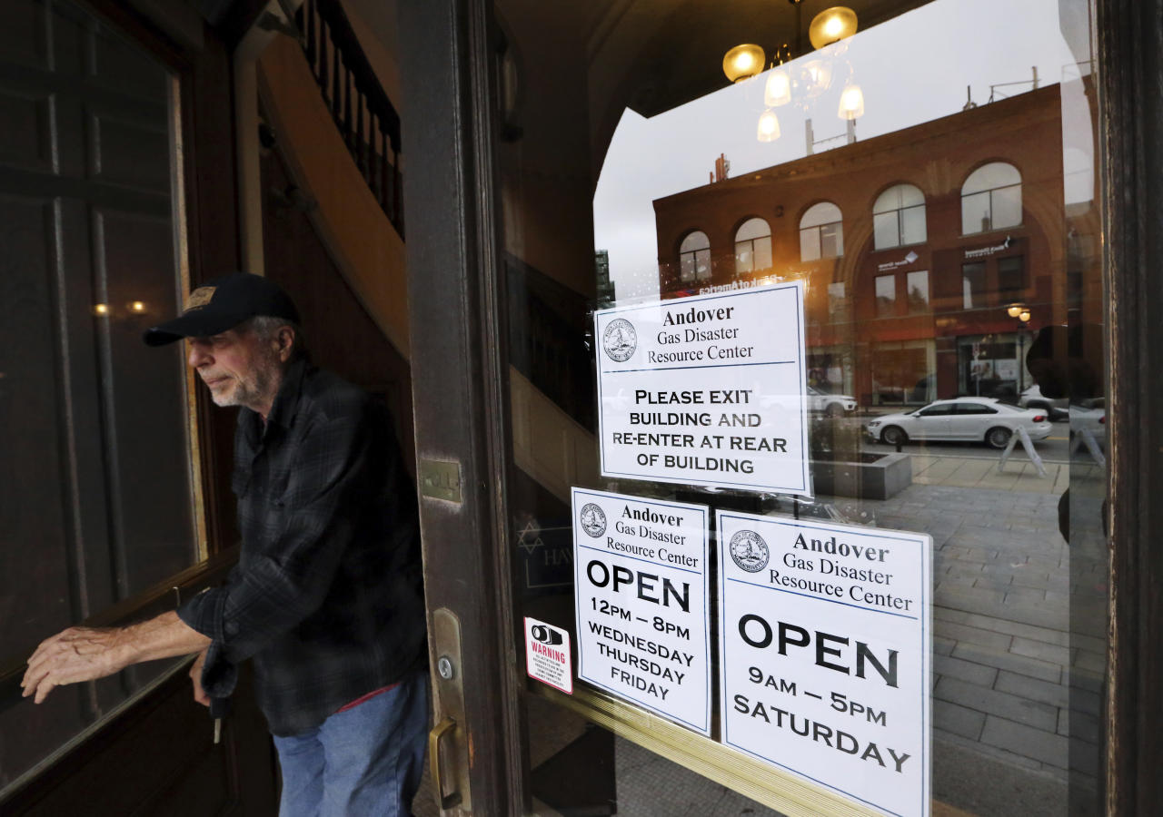 An Andover resident leaves old town hall which is open for claims and information, Wednesday, Sept. 19, 2018, in Andover, Mass., in the wake of last week's gas explosions and fires. About 8,600 customers were affected by the explosions, with many having to evacuate their homes for days, and some possibly having to go without gas service for weeks. (AP Photo/Elise Amendola)