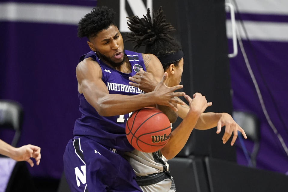 Northwestern guard Anthony Gaines, left, battles for a rebound against Chicago State forward Jordan Polynice during the first half of an NCAA college basketball game in Evanston, Ill., Saturday, Dec. 5, 2020. (AP Photo/Nam Y. Huh)