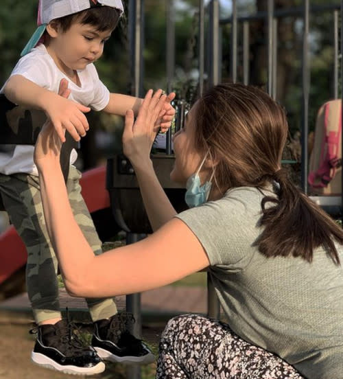 It was Sixto's first time playing in the playground, here with mum Marian Rivera