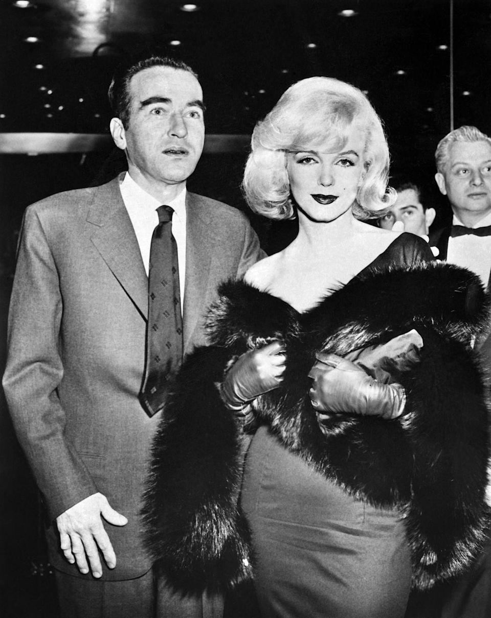 <p>Marilyn Monroe and actor Montgomery Clift arrive at the New York preview of <em>The Misfits</em> in 1961.</p>