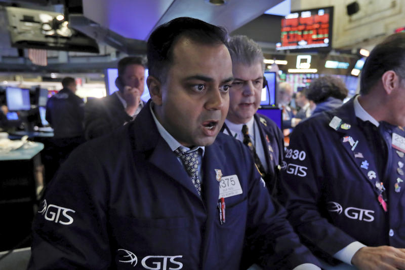 Specialist Dilip Patel, left, works at his post on the floor of the New York Stock Exchange, Monday, March 9, 2020. The Dow Jones Industrial Average sank 7.8%, its steepest drop since the financial crisis of 2008, as a free-fall in oil prices and worsening fears of fallout from the spreading coronavirus outbreak seize markets. (AP Photo/Richard Drew)