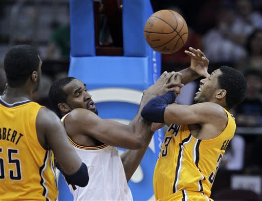 Cleveland Cavaliers' Samardo Samuels and Indiana Pacers' Danny Granger, right, scramble for a loose ball in overtime during an NBA basketball game Wednesday, April 11, 2012, in Cleveland. The Pacers won 104-98. (AP Photo/Mark Duncan)