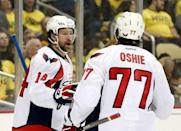 Washington Capitals right wing Justin Williams (14) celebrates his goal with right wing T.J. Oshie (77) against the Pittsburgh Penguins during the third period in game three of the second round of the 2016 Stanley Cup Playoffs at the CONSOL Energy Center. The Pens won 3-2. Mandatory Credit: Charles LeClaire-USA TODAY Sports