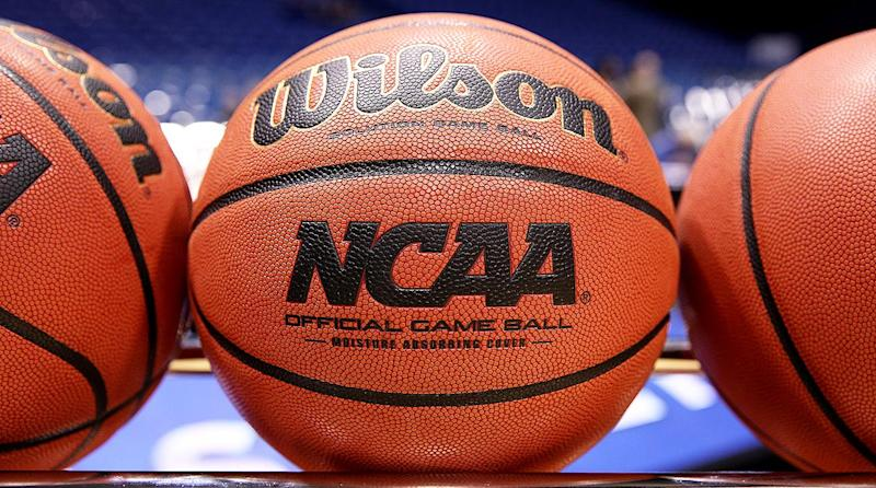 College basketball is seemingly hanging in the balance while the recruiting scandal plays out in court. (Getty)
