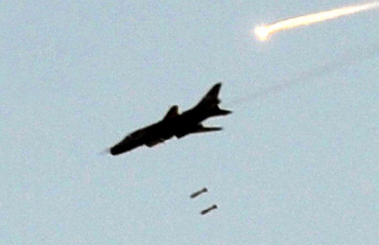 A Syrian army fighter jet bombs the town of Maaret al-Numan. Syrian rebels attacked a key army base in the northwest province of Idlib on Friday, the last regime bastion in the region, and regime warplanes launched air raids in Damascus province, a watchdog says