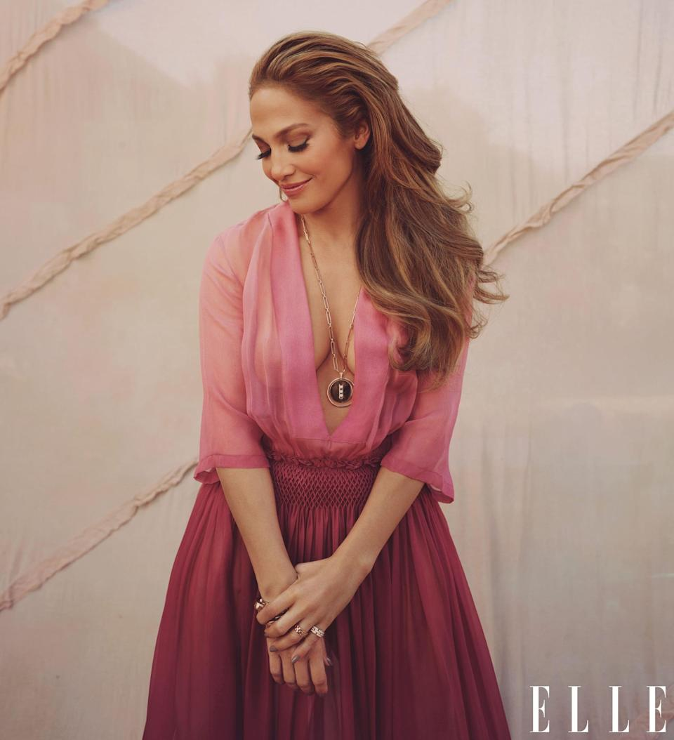<p>J Lo wears a Dior dress with a Messika Paris necklace, Pomellato bracelets, and Cartier rings.</p>
