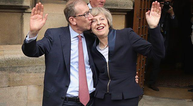 May with her banker husband Philip John. Photo: Getty Images