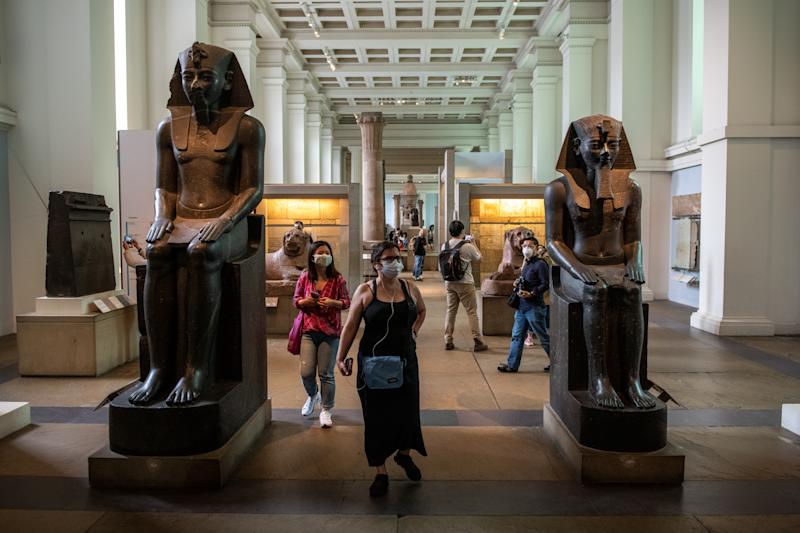 LONDON, ENGLAND - AUGUST 27: Visitors wearing face masks walk through the Egyptian exhibit at the British Museum on August 27, 2020 in London, England. The British Museum has reopened to the public after being closed for 163 days due to Covid-19 restrictions and lockdown. Many other museums have already reopened in the United Kingdom with safety precautions in place to help prevent the spread of Covid-19. (Photo by Chris J Ratcliffe/Getty Images)