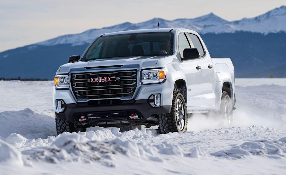 "<p>For extreme off-road use in a mid-size truck, the General Motors product that rocks is the Chevrolet Colorado ZR2. But here's the <a href=""https://www.caranddriver.com/gmc/canyon"" rel=""nofollow noopener"" target=""_blank"" data-ylk=""slk:GMC Canyon"" class=""link rapid-noclick-resp"">GMC Canyon</a>, the Colorado's near-twin brother, and new for 2021 is this husky AT4 package that replaces last year's Canyon All Terrain. The AT4 comes standard with an off-road suspension, front skid plate, and 31-inch Goodyear Wrangler DuraTrac tires. There's also a rear electronic locking limited slip differential and a different looking front bumper to give it that special look. Red tow hooks will come in handy if you find yourself between a rock and a hard place. The standard powertrain is a 308-hp 3.6-liter V-6 with a eight-speed automatic, but an optional 181-hp turbodiesel with a six-speed auto is also available. The AT4 can be built as an extended cab with the six-foot box, or as a crew cab with either the six- or five foot box. Max towing capacity is 7000 lbs. It's no bull that the Canyon can do what most will throw at it, but it's no ZR2 Bison. </p>"