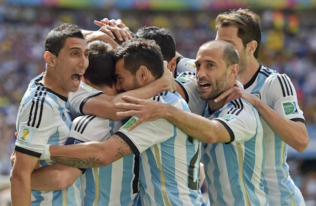Argentina players celebrate after Gonzalo Higuain scored the opening goal during the World Cup quarterfinal soccer match between Argentina and Belgium at the Estadio Nacional in Brasilia, Brazil, Saturday, July 5, 2014. (AP Photo/Martin Meissner)