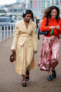 <p>FYI, midi skirt suits are totally a thing - we're loving the pleated details and padded shoulders on this look.</p>