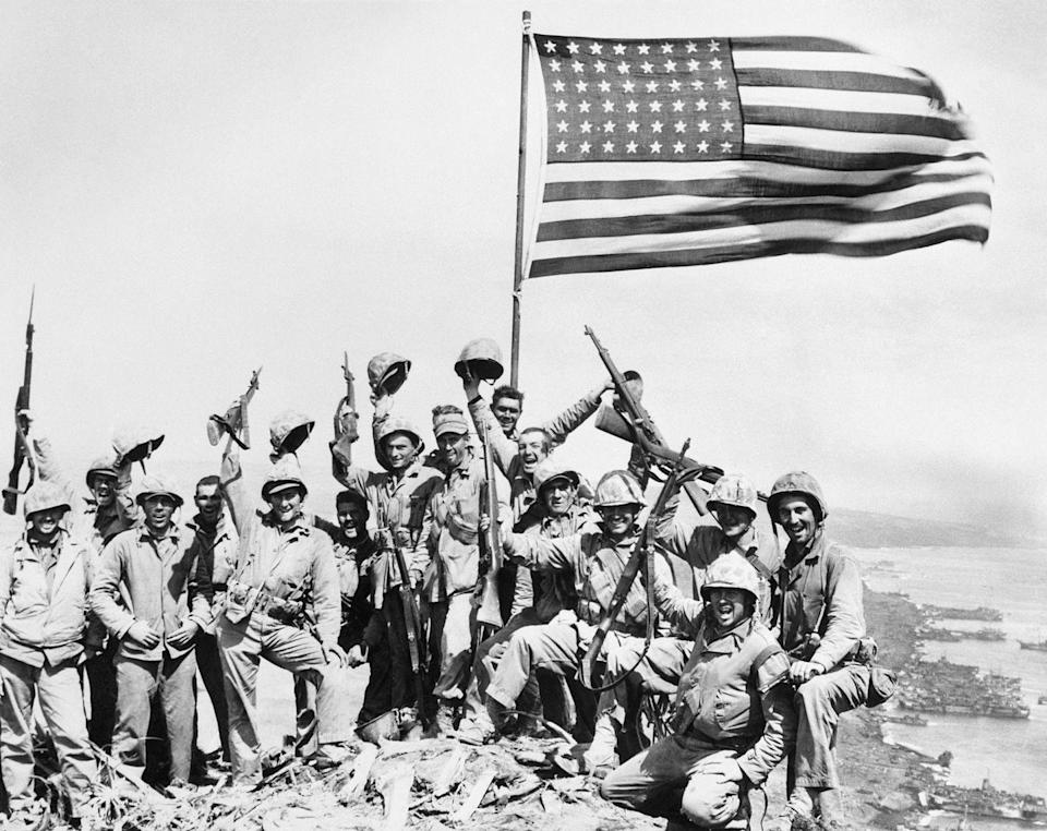 <p>A group of United States Marines celebrate their victory over the Japanese forces following the battle at Iwo Jima. </p>
