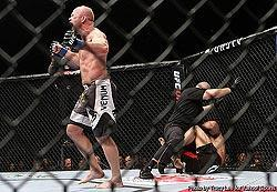 Tim Boetsch (L) celebrates after rallying back to beat Yushin Okami by KO in the third round
