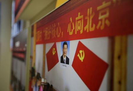 A picture shows Chinese President Xi Jinping's portrait during an exhibition displaying China's achievements for the past five years, as a part of the celebrations of the upcoming 19th National Congress of the Communist Party of China (CPC) at Beijing Exhibition Centre in Beijing, China October 10, 2017.  REUTERS/Jason Lee