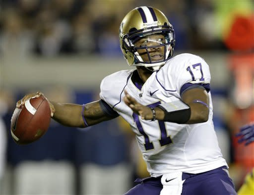 Washington quarterback Keith Price throws against California during the first half of an NCAA college football game in Berkeley, Calif., Friday, Nov. 2, 2012. (AP Photo/Marcio Jose Sanchez)