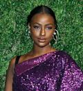 <p>If you've always taken risks with your makeup, why should your wedding be any different? Against a white dress, a pop of bright shimmery eye shadow like Justine Skye's is so welcoming! </p>
