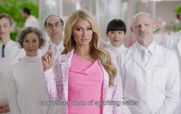 The 36-year-old socialite appears in a new video, promoting a mini drop of water called the NanoDrop - her solution to less plastic pollution! Source: Paris Hilton/Facebook