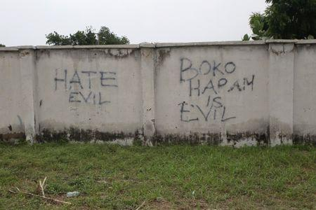 Writings describing Boko Haram are seen on the wall along a street in Bama, in Borno, Nigeria August 31, 2016. Picture taken August 31, 2016. REUTERS/Afolabi Sotunde