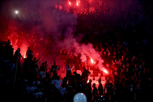 Partizan Belgrade fans light torches during match against Red Star in Belgrade, Serbia April 14, 2018. REUTERS/Djordje Kojadinovic