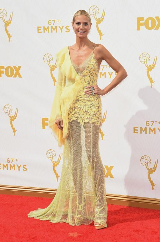 <p>Heidi Klum gave off major Big Bird vibes in a yellow dress from from Altelier Versace's Fall/Winter 2015 collection. The couture gown featured a single ruffle shoulder, sheer beaded skirt and leaves appliquéd on the bodice.</p>