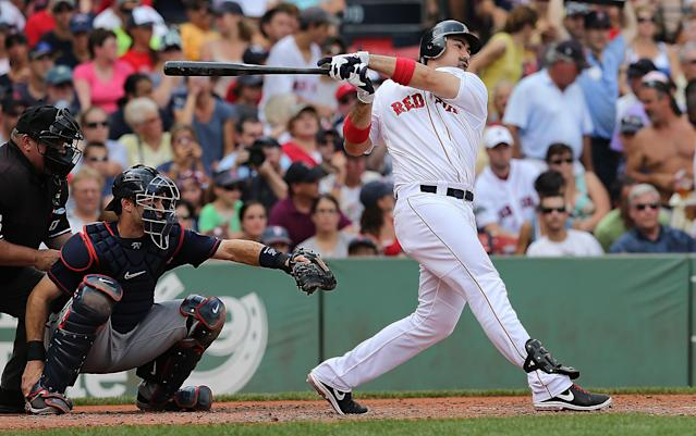 BOSTON, MA - AUGUST 5: Adrian Gonzalez #28 of the Boston Red Sox knocks in a run in the third inning against the Minnesota Twins in the first inning at Fenway Park August 5, 2012 in Boston, Massachusetts. (Photo by Jim Rogash/Getty Images)