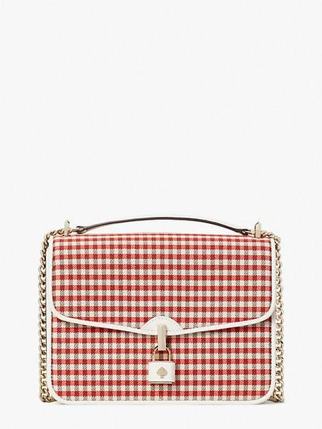 <p>Nothing says spring quite like this <span>Kate Spade New York Locket Plaid Large Flap Shoulder Bag</span> ($378).</p>