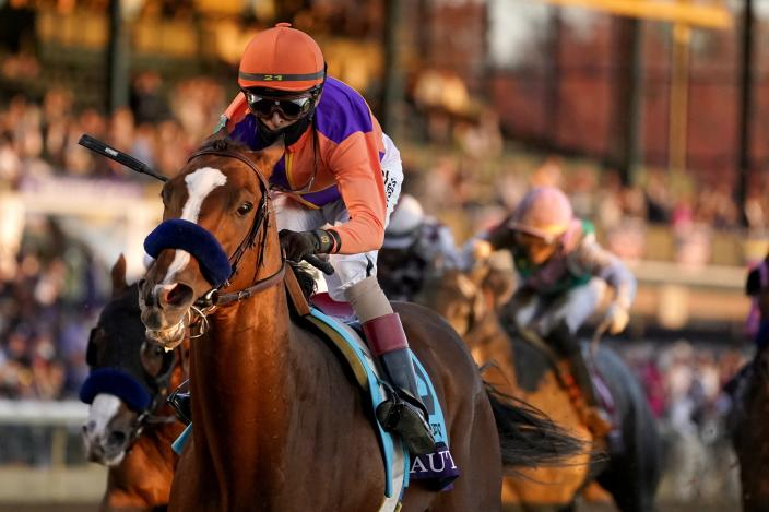 John Velazquez (9) rides Authentic to win the Breeder's Cup Classic horse race at Keeneland Race Course, in Lexington, Ky., Saturday, Nov. 7, 2020. (AP Photo/Darron Cummings)