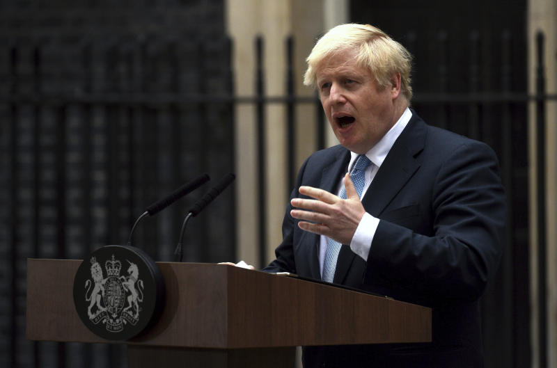Britain's Prime Minister Boris Johnson speaks to the media outside 10 Downing Street in London, Monday, Sept. 2, 2019. Johnson says he doesn't want an election amid Brexit crisis and issued a rallying cry to lawmakers to back him in securing Brexit deal.(Kirsty O'Connor/PA via AP)