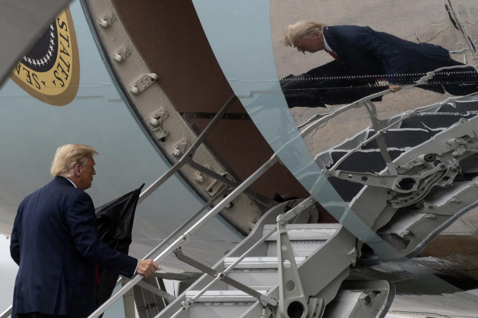 President Donald Trump boards Air Force One, Monday, Oct. 12, 2020, at Andrews Air Force Base, Md. Trump is en route to Florida. (AP Photo/Alex Brandon)