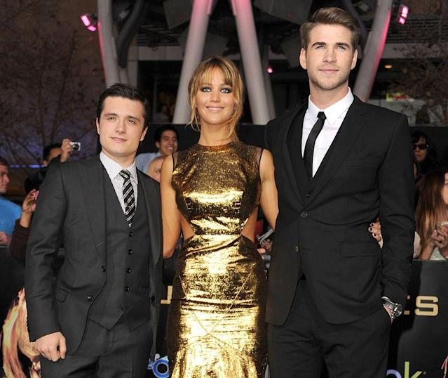 """<p>The now 20-year-old rising star lands the coveted role of Katniss Everdeen in <i>The Hunger Games</i> series based on the popular YA novels. She appears at the Los Angeles premiere with co-stars <a href=""""https://www.yahoo.com/entertainment/tagged/josh-hutcherson"""" data-ylk=""""slk:Josh Hutcherson"""" class=""""link rapid-noclick-resp"""">Josh Hutcherson</a> (left) and <a href=""""https://www.yahoo.com/entertainment/tagged/liam-hemsworth"""" data-ylk=""""slk:Liam Hemsworth"""" class=""""link rapid-noclick-resp"""">Liam Hemsworth</a> (right) on March 12, 2012. (Photo: Getty Images) </p>"""
