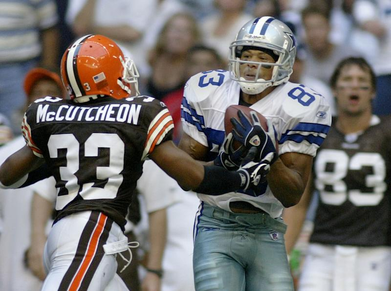 Dallas Cowboys wide receiver Terry Glenn (R) pulls in a 37 yard reception over Cleveland Browns Daylon McCutcheon (L) during second half action at Texas Stadium in Irving, Texas, September 19, 2004. Glenn led all receivers with 90 yards in the Cowboys' 19-12 win. REUTERS/Paul Buck PKB