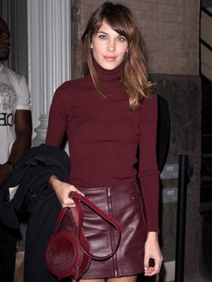 This Brit sure knows how to wear her leather. Alexa Chung attends a cocktail party at Versace Boutique in New York City wearing a burgundy Alexander McQueen Leather mini skirt.