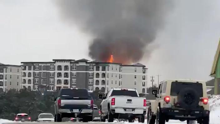 <p>Smoke rises from a building on fire, in San Antonio, Texas, US February 18, 2021, in this still image taken from a social media video. </p> (JOHN ALBRIGHT via REUTERS)