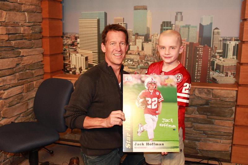 "In this photo released by Andy Hoffman, 7-year-old Jack Hoffman, right is seen with actor James Denton in Minneapolis on Tuesday, May 28, 2013. The 7-year-old boy and cancer patient who had a trading card issued in his honor after he ran roughshod over the Nebraska Cornhuskers has found new buyers for cards set aside for his charity. Among those stepping up: actor James Denton, best known from the series,""Desperate Housewives."" (AP Photo/Courtesy of Andy Hoffman)"