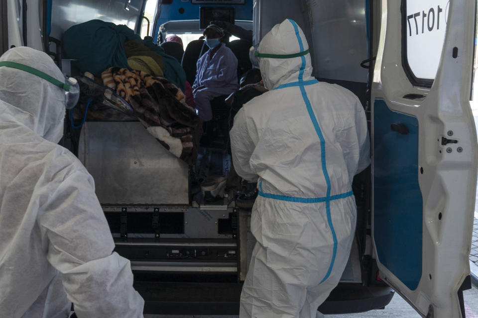 Health workers arrive with a patient at the Chris Hani Baragwanath Academic Hospital's COVID-19 facility, in Johannesburg, Monday, June 21, 2021. The head of the World Health Organization, Tedros Adhanom Ghebreyesus, said Monday the U.N. agency is in discussions with numerous companies and institutions to create a technology transfer hub for coronavirus vaccines in South Africa. (AP Photo/Shiraaz Mohamed)