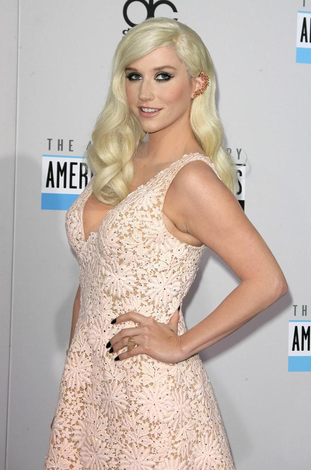 AMAs 2012: Wowzers, we almost didn't recognise Ke$ha here – normally she's wearing torn up tights and hasn't brushed her hair. This cute pink dress and perfectly styled hair is a HUGE improvement. Copyright [WENN]