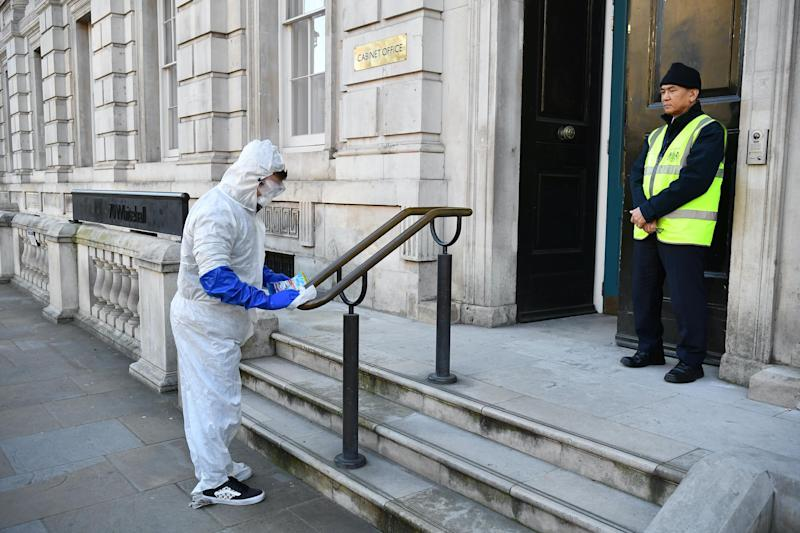 kids create a tiktok video in fake hazmat suits outside the Cabinet Office after a COBRA meeting: Leon Neal/Getty Images