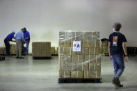 Members of Khalsa Aid USA, a global humanitarian organization, prep pallets of electrical transformers for shipping to New Delhi on New York's Long Island, Friday, May 7, 2021. The organization will send 500 oxygen concentrators alongside the transformers to provide support for COVID-19 patients across India. (AP Photo/Jessie Wardarski)
