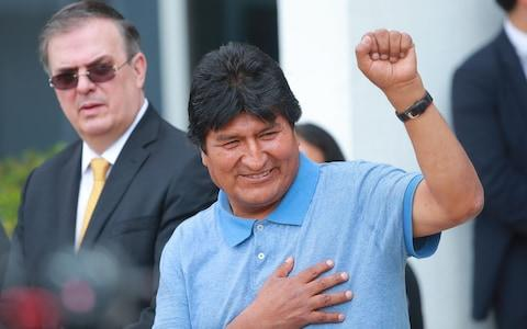 Former Bolivian president Evo Morales greets the press as he arrives to Benito Juarez International Airport after accepting the political Asylum granted by Mexican Government at Benito Juarez International Airport on November 12, 2019 - Credit: Hector Vivas/Getty Images South America