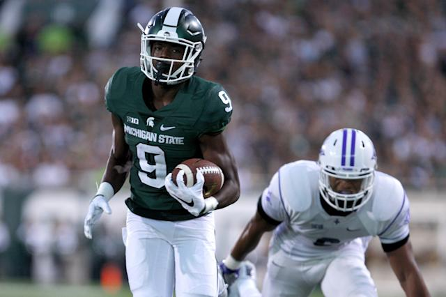 Michigan State receiver Donnie Corley, left, runs for a first down on a pass reception against Furman's Thomas Brown during the second quarter of an NCAA college football game, Friday, Sept. 2, 2016, in East Lansing, Mich. (AP Photo/Al Goldis)