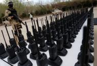 FILE PHOTO: An armed soldier stands guard next to communication radios displayed to the media at a military base in Ciudad Juarez