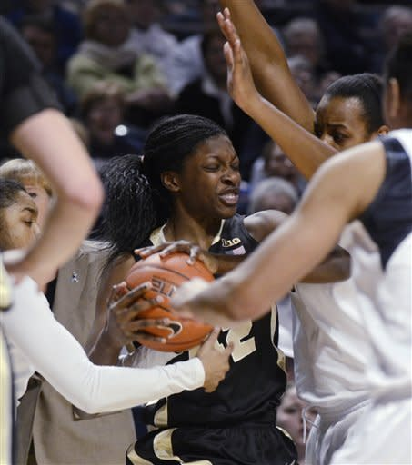 Purdue's KK Houser (22) tries break through numerous Penn State defenders during the first half of an NCAA college basketball game in State College, Pa., Monday, Feb. 4, 2013. (AP Photo/Ralph Wilson)